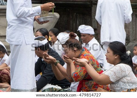 PURA TIRTA EMPUL, BALI, INDONESIA - AUGUST 17, 2016 - This temple is a bathing structure, famous for its holy spring water, where Balinese Hindus go to for ritual purification.