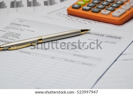 Purchase order form with pen and calculator
