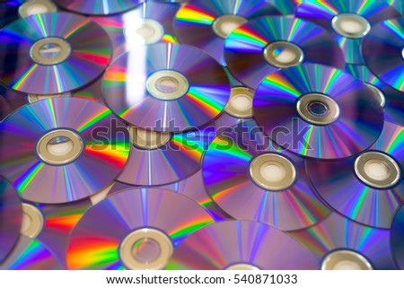 purple and rainbow color surface cd compact disk and DVD digital versatile disc background