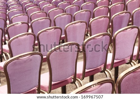 purple chairs in a conference room
