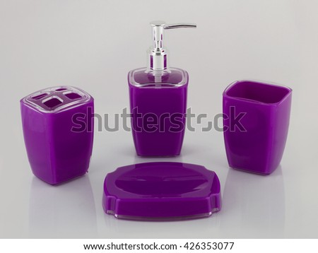 Several glass items isolated on white stock photo 55520755 for Purple glass bathroom accessories