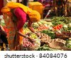 PUSHKAR, INDIA - NOVEMBER 19:Unidentified woman sells vegetables at fair on November 19, 2010 in Pushkar, Rajasthan, India. Pilgrims and camel traders flock to the holy town for the annual fair. - stock photo
