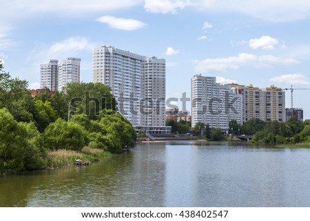 PUSHKINO, RUSSIA, on MAY 30, 2016. City landscape. Multystoried houses on the river bank of Serebryanka