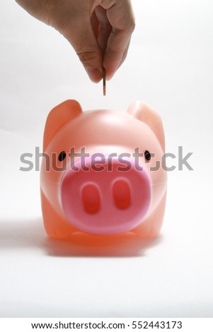 Put a coin into a piggy bank