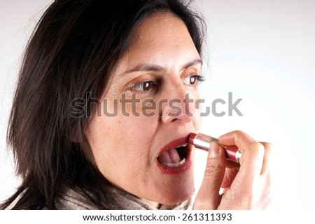 Putting lipstick on