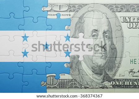 puzzle with the national flag of honduras and dollar banknote . concept