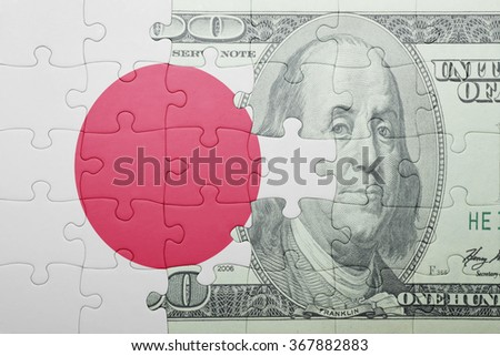 puzzle with the national flag of japan and dollar banknote . concept