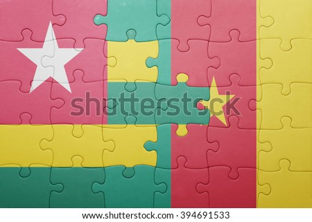 puzzle with the national flag of togo and cameroon . concept
