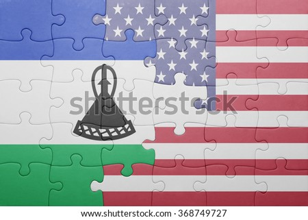puzzle with the national flag of united states of america and lesotho .concept