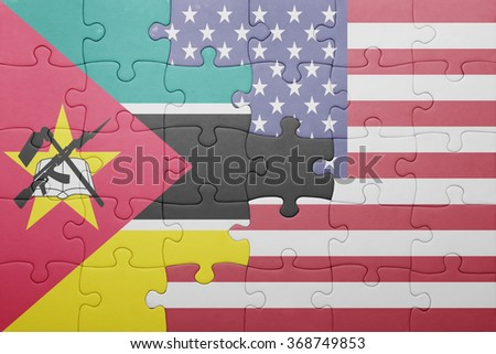 puzzle with the national flag of united states of america and mozambique .concept