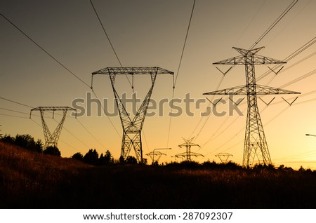 Pylon high voltage power lines silhouette in sunset at Fairwood, King County, Washington State, USA