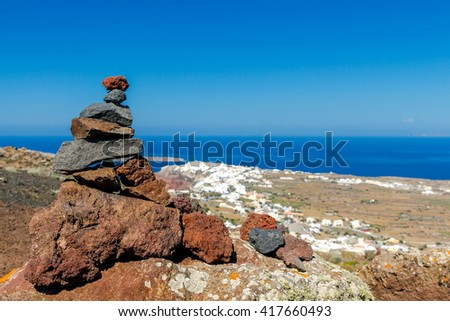 Pyramid of stones on top  mountain.