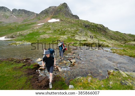 PYRENEES, SPAIN - CIRCA JULY, 2015 - Two girl walking in the Spanish Pyrenees (GR11 trail).