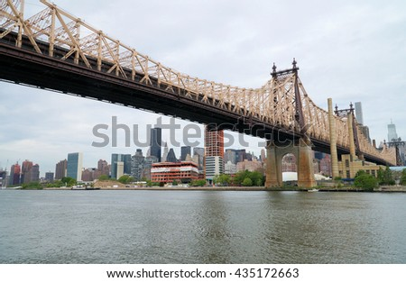 Queensborough Bridge in Midtown Manhattan and East River. New York City, USA.