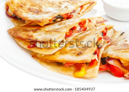 Quesadilla on a plate. Mexican. A kind of tortilla. Latin cuisine.