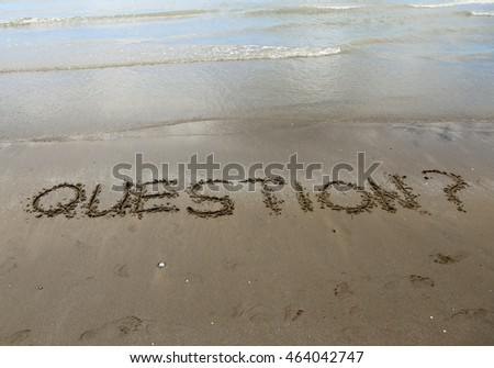 QUESTION big written on the beach sand