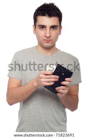 quiet young man showing his wallet with money (isolated on white background)
