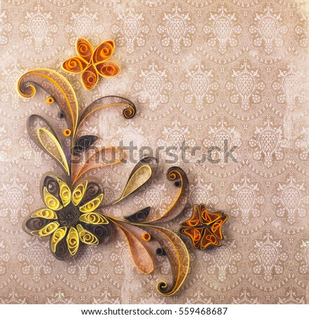 Quilling on a brown background