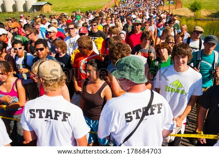 QUINCY, WA - JULY 26, 2006: Crowd of people being let into the gates at Creation NW, a 4 day Christian concert festival at the Gorge Ampitheater in Washington.