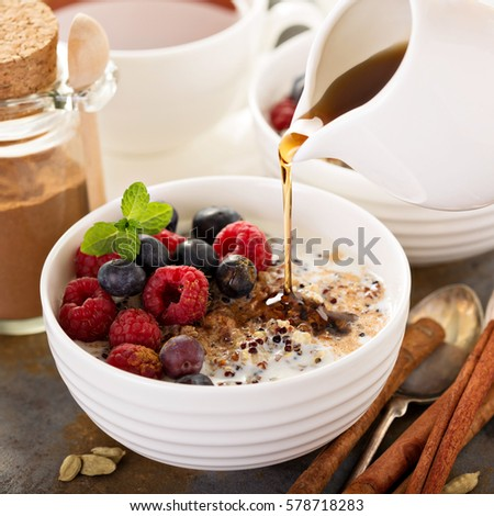 Quinoa porridge with raspberry, blueberry and cinnamon for breakfast