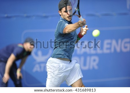 RAANANA, ISRAEL - April 02, 2016: Professional tennis player Thomas Fabbiano in action  at the semi-final match during the ATP Challenger Tour 2016 at Raanana, Israel