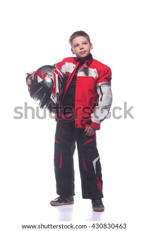 race car or bike driver the boy in the costume of the racer holding a