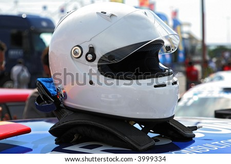 racing helmet on top of a racing car