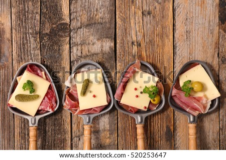 raclette cheese and meats