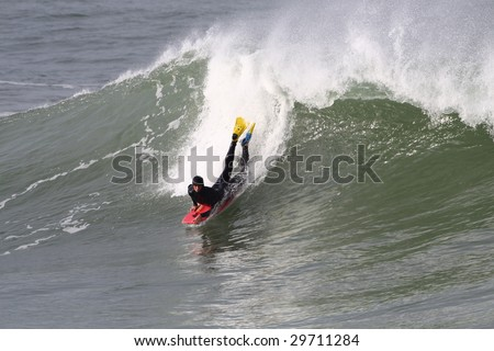 radical bodyboarder in action on a powerful wave
