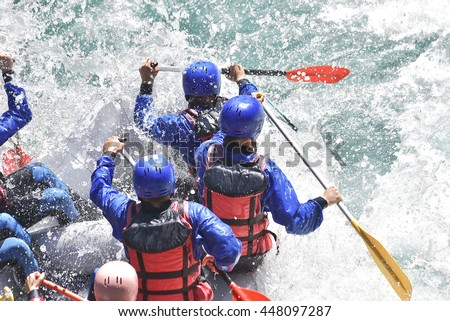 Rafting team splashing the waves, rafting extreme and fun sport