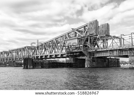 Railroad draw bridge on Connecticut river,  taken from a boat. Monochrome image.