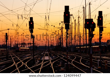 Railroad Tracks at a Major Train Station at Sunset.