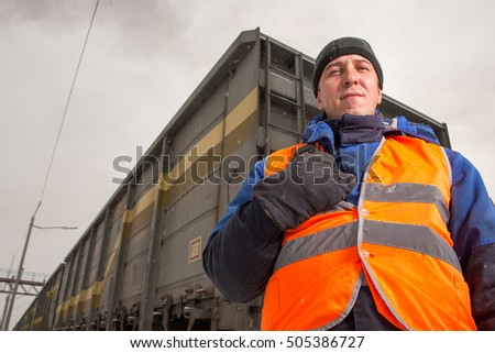 Railroad worker with wagon on the background