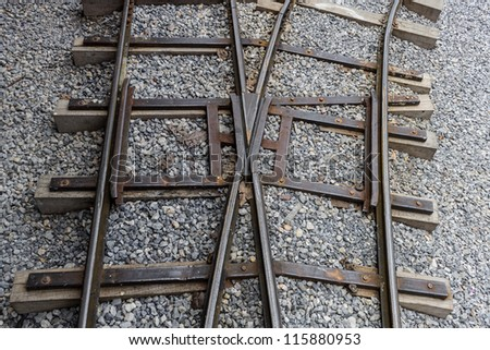 Railway track junction on a gravel bed.