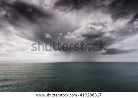 rain and stormy cloud on the sea