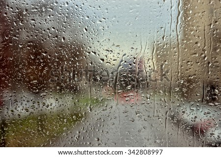 Rain drops covering window glass