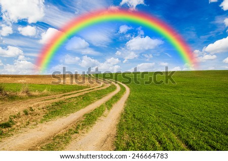 rainbow and green field