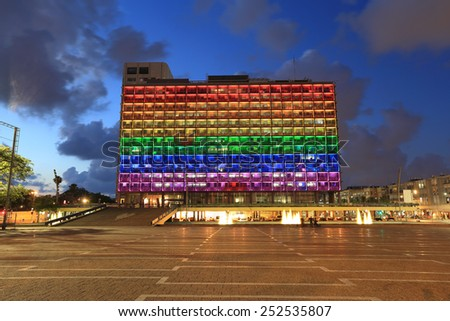 Rainbow flag lighting over Tel Aviv city hall building for pride month