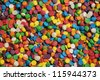 Rainbow sprinkle background closeup wallpaper - stock photo
