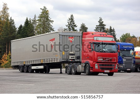 RAISIO, FINLAND - SEPTEMBER 23, 2016: Red Volvo FH semi truck hooks up to a cargo trailer on a truck stop yard in South of Finland.