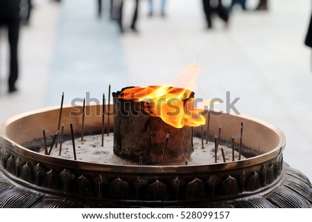 Ranging fire in a Japanese Buddhist incense burner in Nara