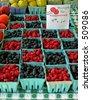 raspberries and blackberries for sale at farmer's market - stock photo