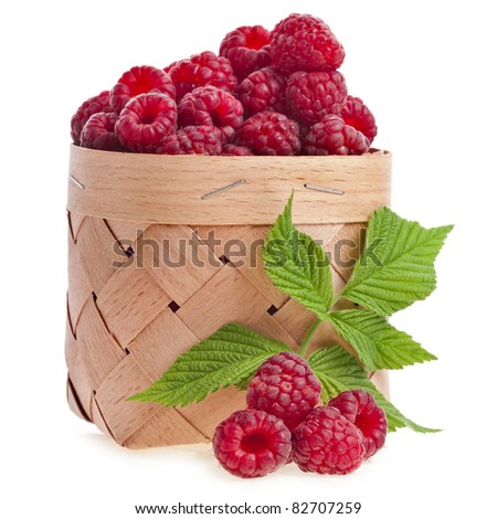 raspberries in the wooden basket isolated on white