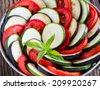 Ratatouille, stewed vegetable dish with tomatoes, zucchini, eggplant  before cooking  - stock