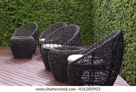 Rattan Garden Table And Chairs With Water Resistant Outdoor. Patio Furniture  In A Beautiful Garden