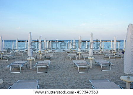Ravenna, late afternoon at Adriano sand beach with umbrellas and deckchairs for summer vacations
