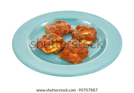 Ravioli with tomato sauce on a blue plate.