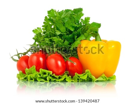 Raw bright vegetables on a lettuce leaves over white background