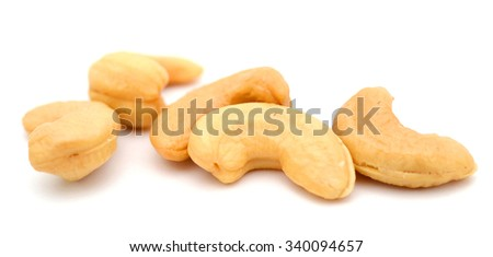 raw cashew nuts on white background