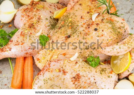 Raw chicken covered with spices ready for cooking